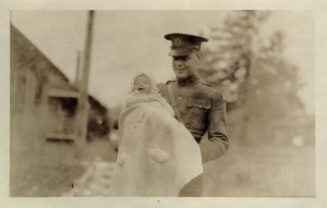 """This January 1924 postcard labeled """"Junior's Smile"""" shows Doc and Sonny while in Fort Lewis, Washington."""