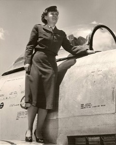 Jeanette Kapus posing on the wing of an F-86 Sabre.