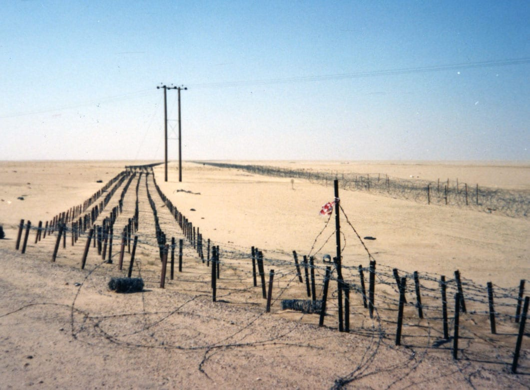 Twenty-foot wide stretches of tanglefoot left by Iraqi troops.