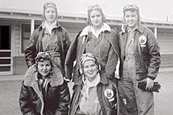 Fellow WASPs posing together in their flight gear.