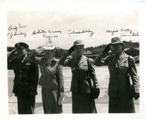 This May 1943 photo from Theresa Dischler's collection was taken during a review at Bolling Field, Washington D.C. marking the one year anniversary of the creation of the WAAC. The inspecting group includes WAAC creator Representative Edith Nourse Rogers and first WAAC director Colonel Oveta Culp Hobby in the center, in addition to Brigadier General T. J. Hanley and Major Betty Bandel, Deputy Director of the WAAC.