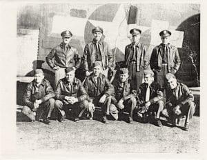 Leonard Schutta's crew. Schutta is kneeling in the front row on the left.