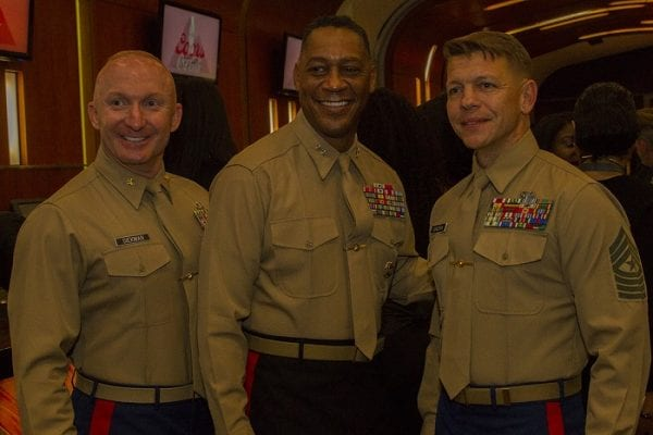 Sergeant Major Corcoran appears on the right. Major General Craig C. Crenshaw, commanding general of Marine Corps Logistics Command, stands in between Maj. Christopher M. Siekman, commanding officer of Recruiting Station Baton Rouge, and Sgt. Maj. Shawn Corcoran, sergeant major of Recruiting Station Baton Rouge, as they pose for a photo during the Bayou Classic Welcome Reception Nov. 25, 2016, at the West Bunker Club in the Mercedes-Benz Superdome, New Orleans, Louisiana. The appearance of U.S. Department of Defense (DoD) visual information does not imply or constitute DoD endorsement. 3015184. Public domain.